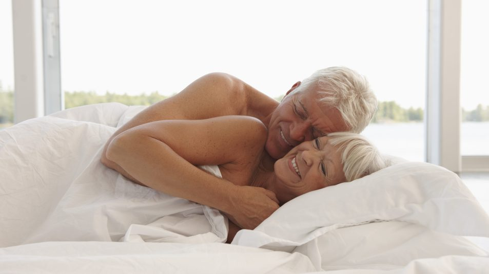Pic of happy mature couple having sex on bed